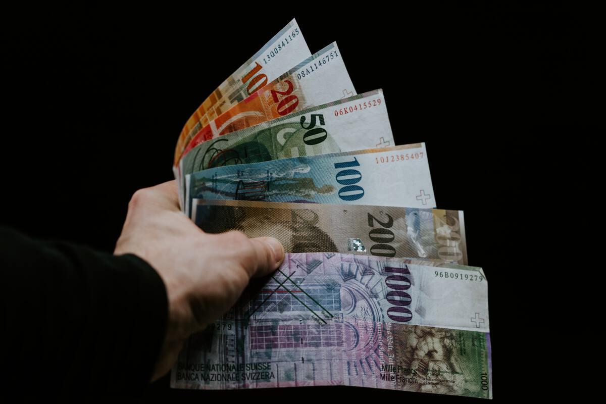 money cash Photo by Claudio Schwarz on Unsplash